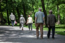 Men and Women walking on a path