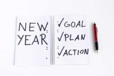 notebook with new year's action plan